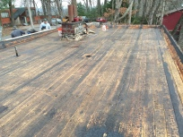 Tongue and groove wood decking after metal, EPDM and built-up roofs were removed.